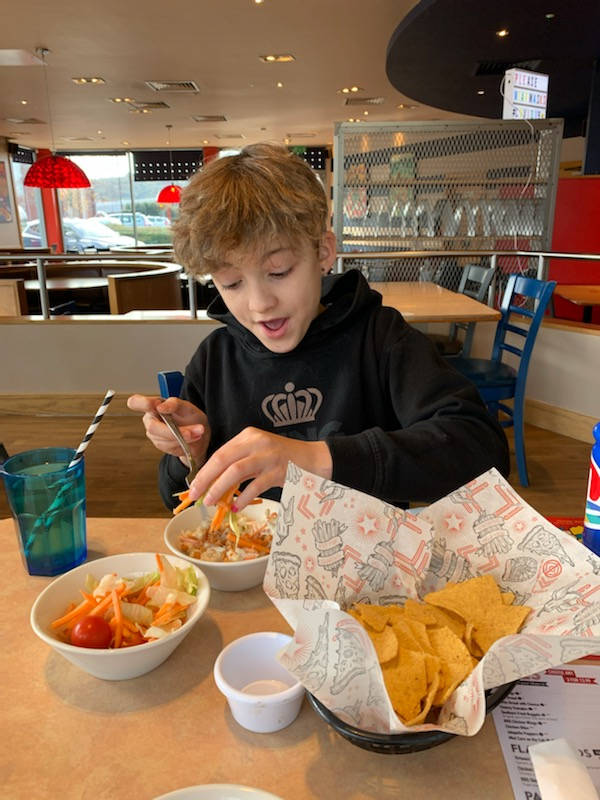 boy eating out